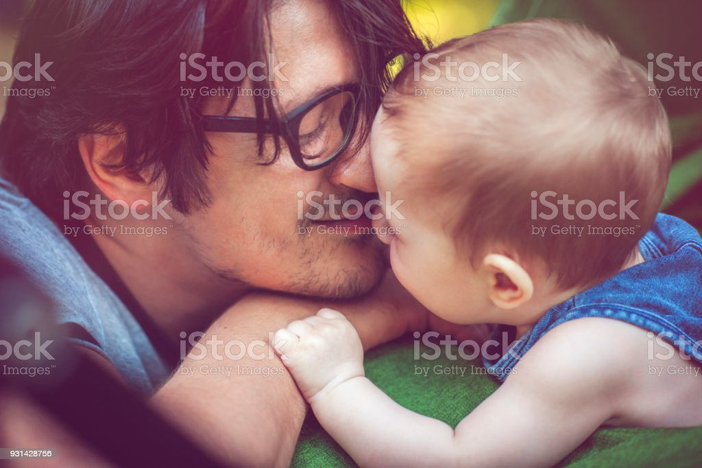 Father with Baby Outdoors stock photo