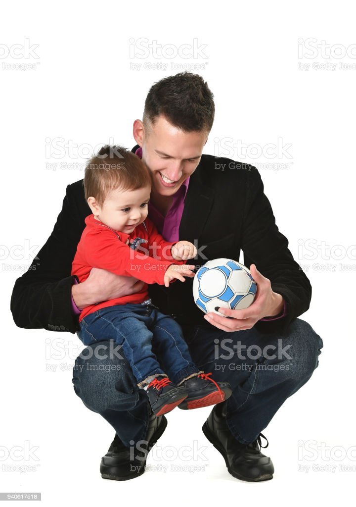 Father with baby son and ball stock photo