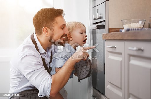 istock father with   child   son prepares meal, bakes cookies 959011668