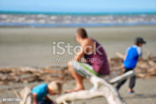 istock Father with Children at Beach, Completely Defocussed 641607190