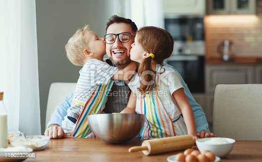 istock father with children   baking cookies 1150232966