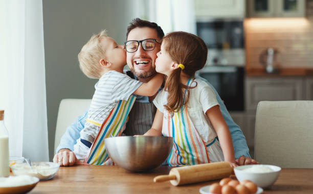 father with children   baking cookies father with children preparing food, baking cookies father stock pictures, royalty-free photos & images