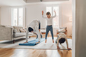 Father with children exercising at home