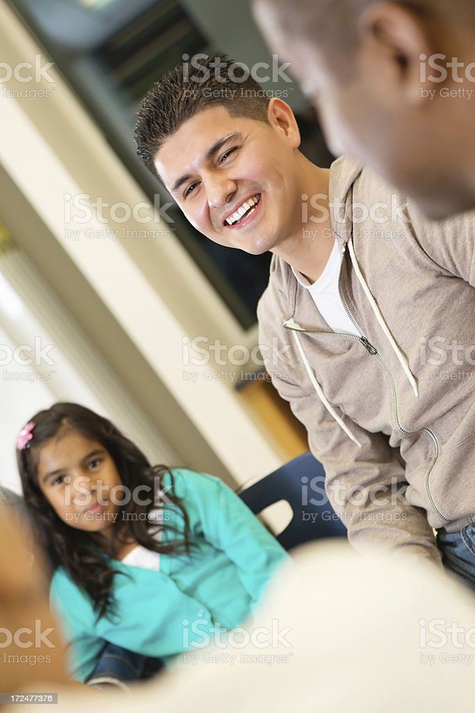 Father with daughter at school conference or meeting