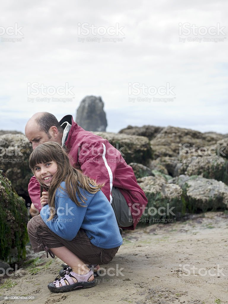 Father with daughter (8-9) on beach royalty-free stock photo
