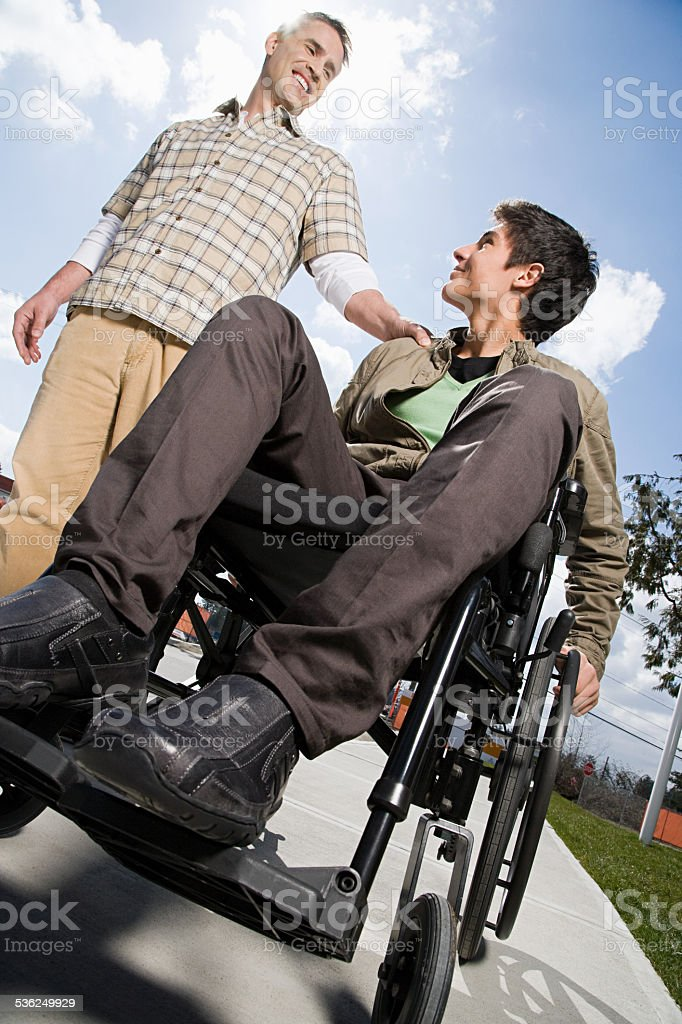 Father with disabled son stock photo