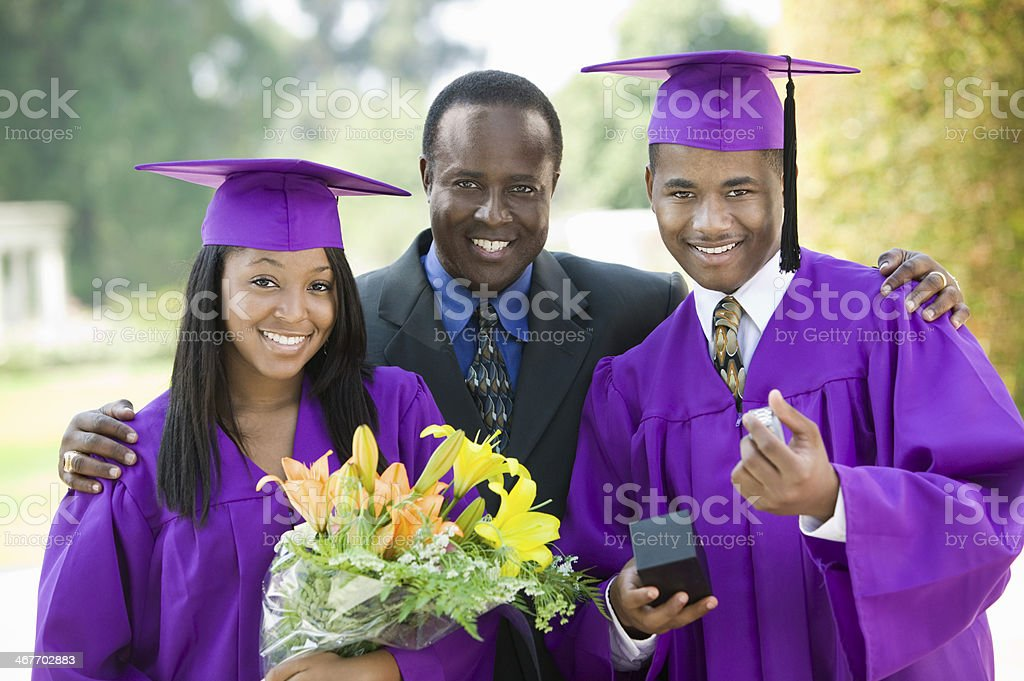 Father with Graduates stock photo