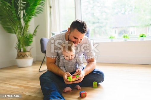 istock father with his child son play together at home 1175925401