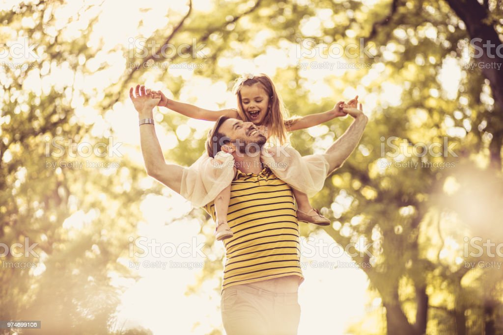 Father with his little girl playing in nature. Spring season. stock photo