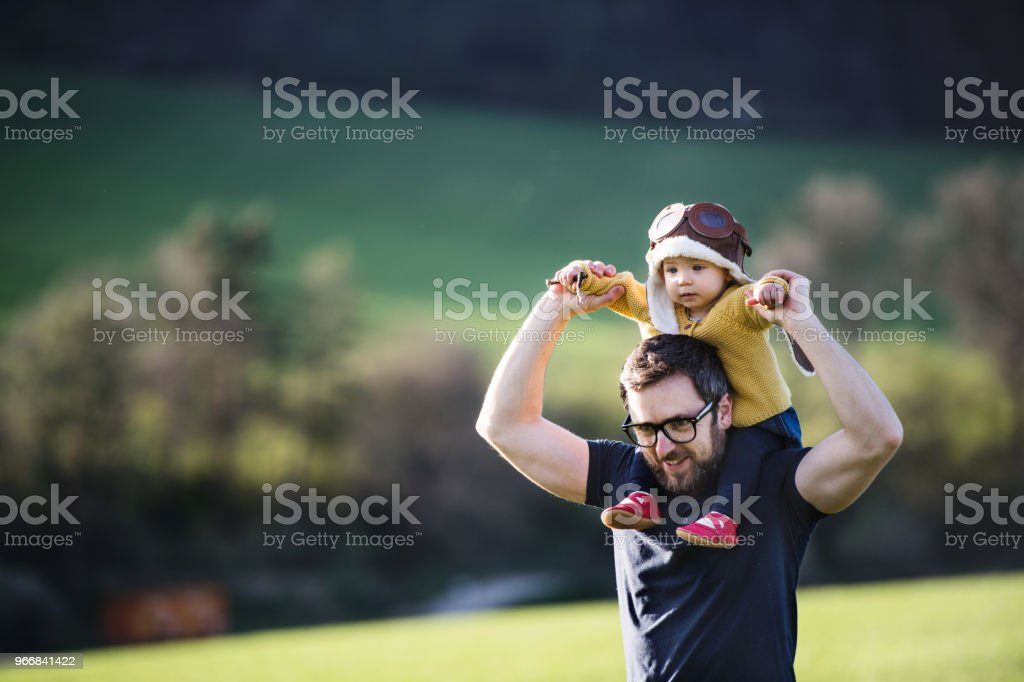 A father with his toddler daughter outside in spring nature. royalty-free stock photo
