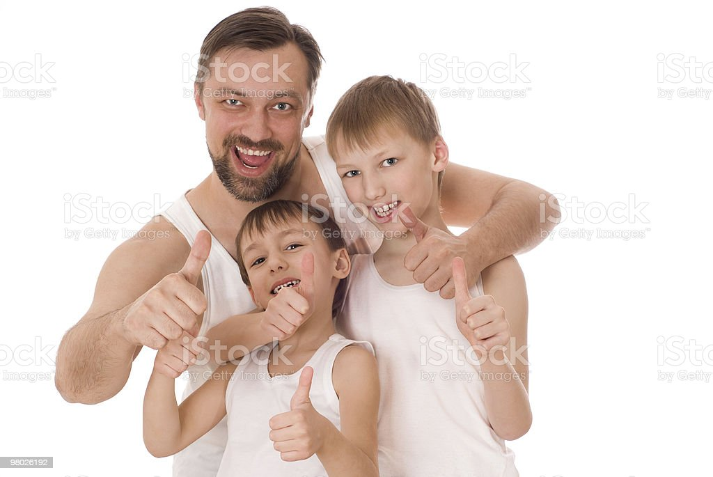 father with his two sons standing royalty-free stock photo