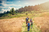 Father with kids hiking in beautiful nature