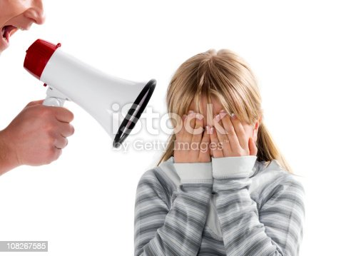 istock Father with megaphone yelling on his daughter 108267585