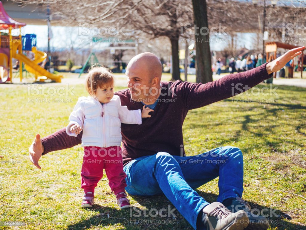 Father with one year old baby girl in nature stock photo