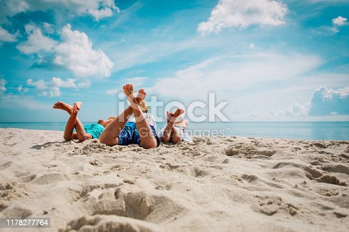 father with son and daughter relax on beach vacation