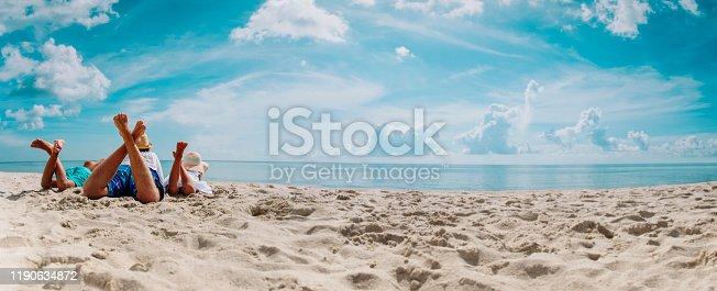 father with son and daughter relax on beach vacation, family at sea, panorama