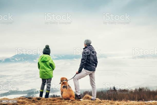 Father with son and dog look together on winter mountain city picture id860148744?b=1&k=6&m=860148744&s=612x612&h=c18l5ft smvu2u2lnljmo0b74 j0zc0b 37s0ioitoa=