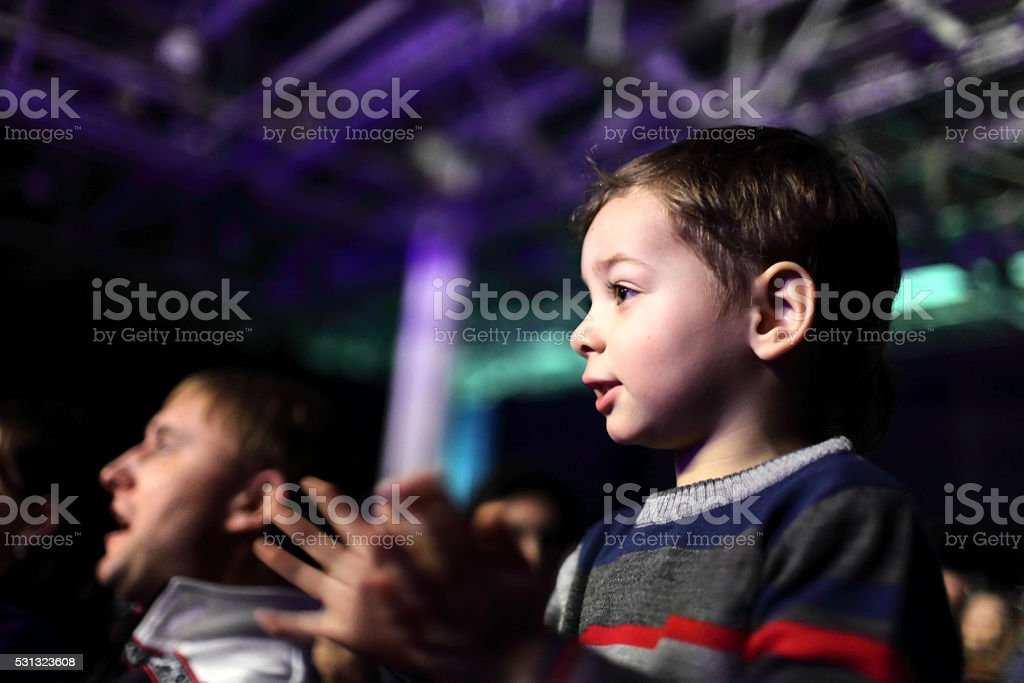 Father with son at a concert stock photo