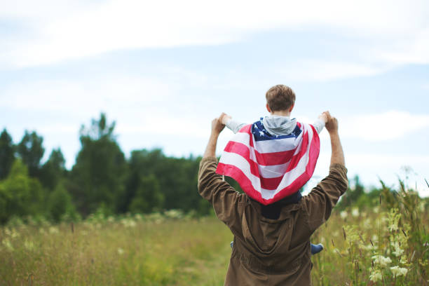 Father with son celebrating Independence day stock photo