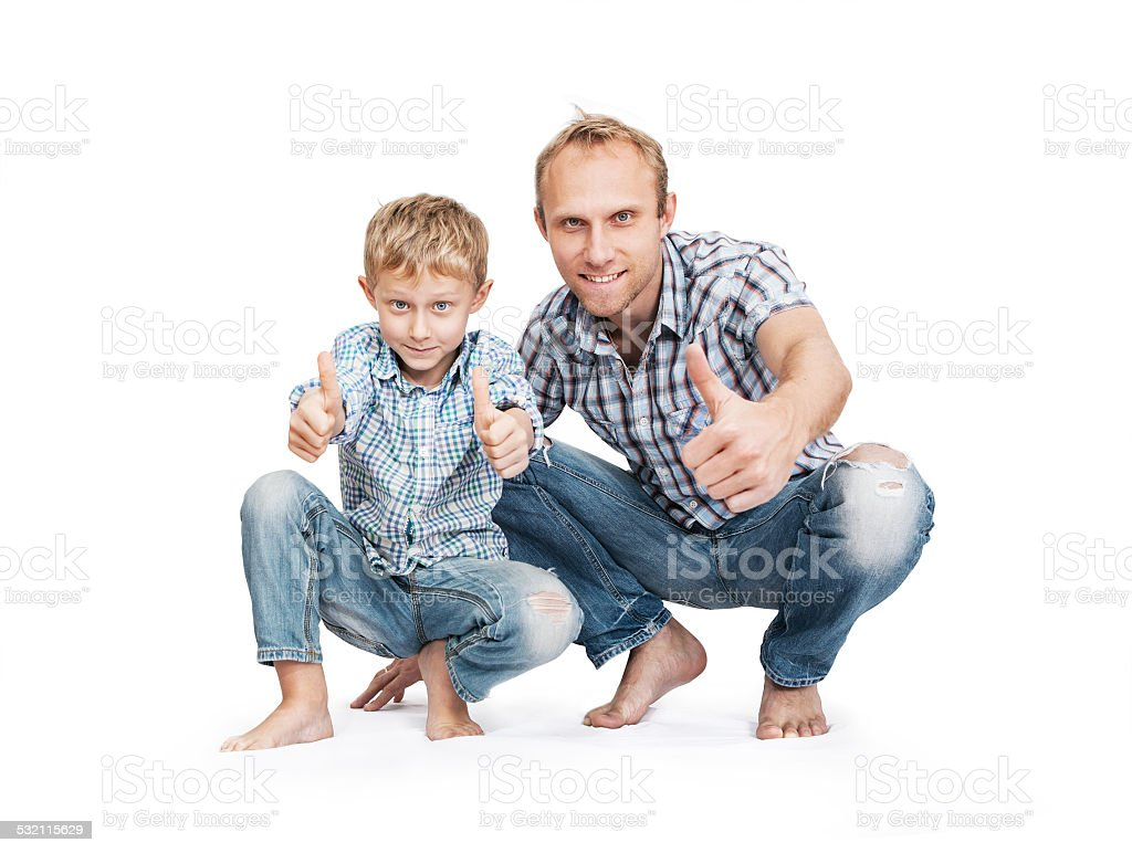 Father with son in blue tattered jeans with great gesture stock photo