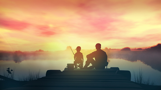 Father and son catch fish from a wooden pier at sunrise.