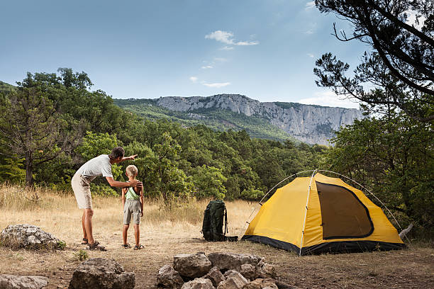 Father with son in the summer camping stock photo