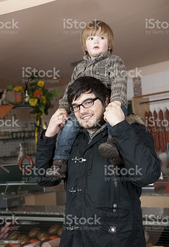 Father with son on his shoulders royalty-free stock photo