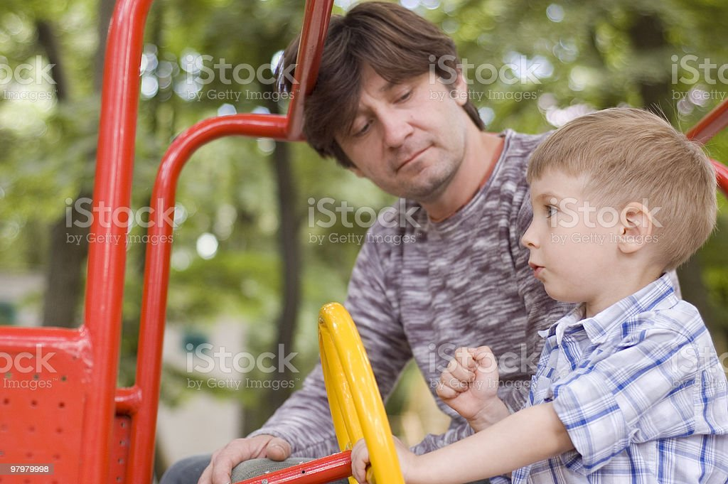 father with son play on playground royalty-free stock photo