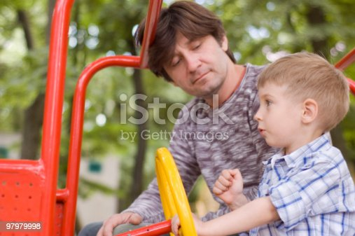 496487362istockphoto father with son play on playground 97979998