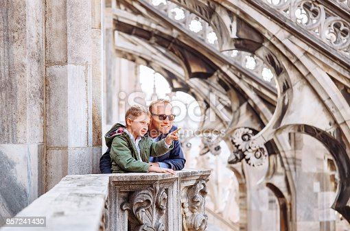 istock Father with son tourists are on the roof of Milan Cathedral 857241430