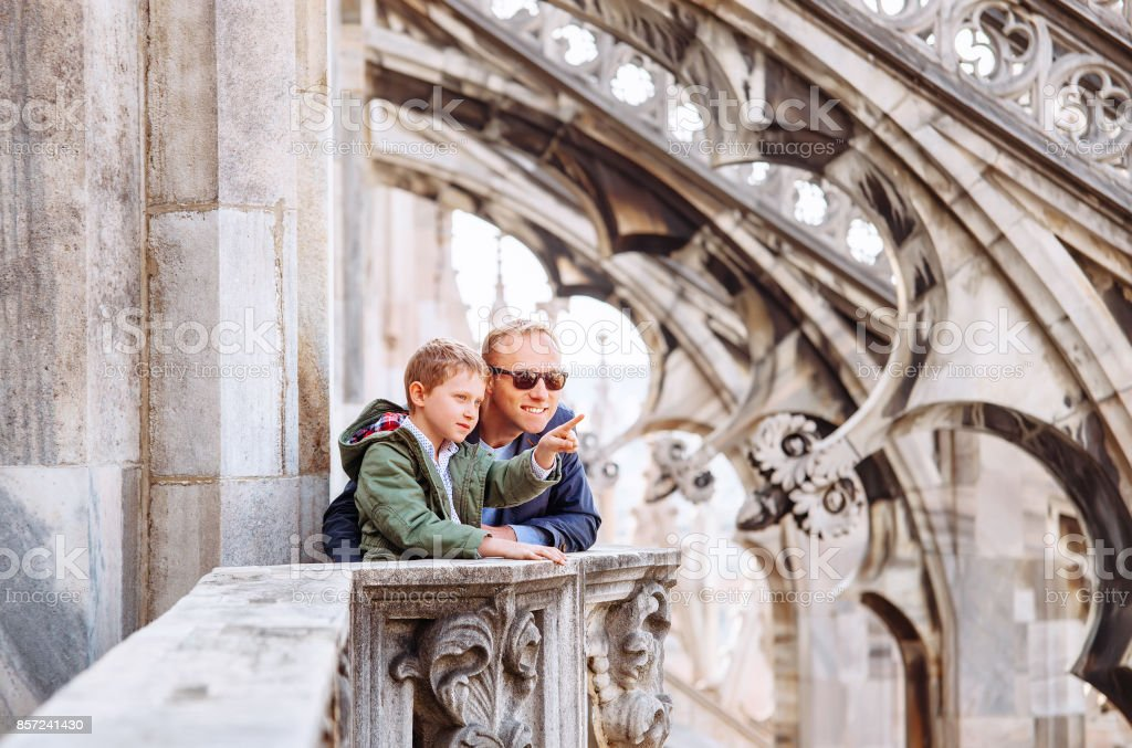 Father with son tourists are on the roof of Milan Cathedral stock photo