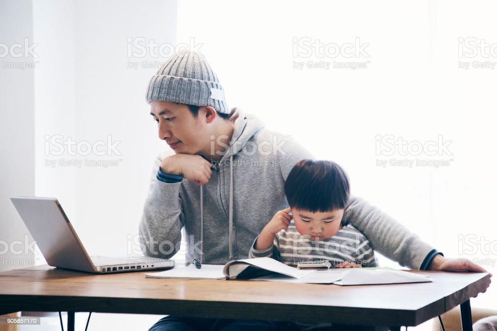 Father with son working at home stock photo