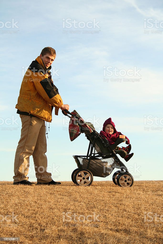 father with stroller royalty-free stock photo