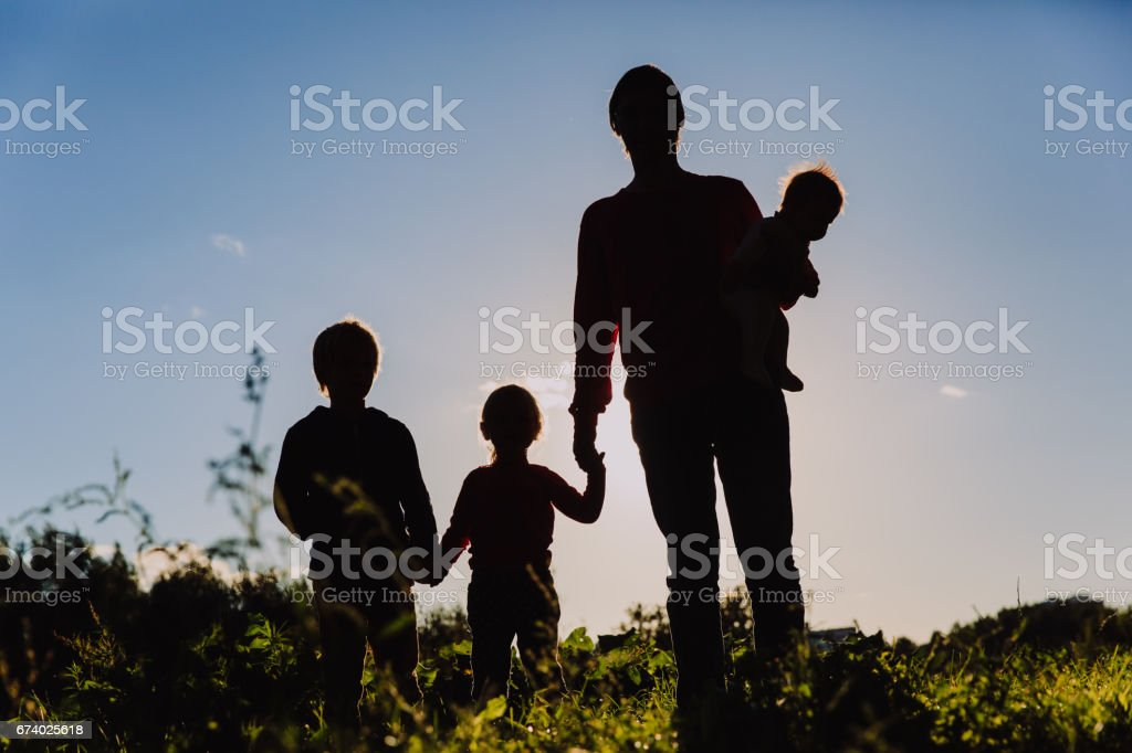 father with tree kids walk in sunset nature royalty-free stock photo