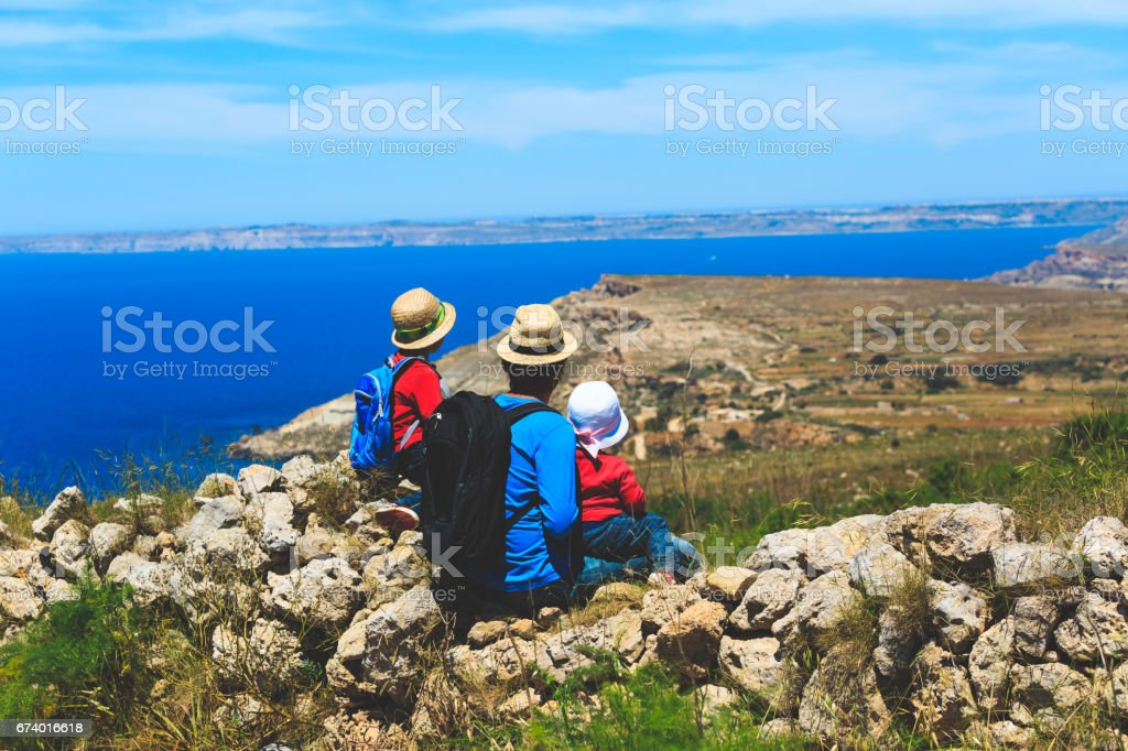 father with two kids travel hiking in mountains royalty-free stock photo