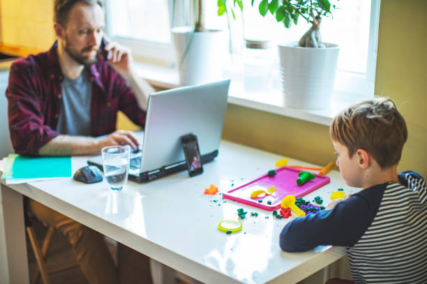 Father working from home during quarantine stock photo