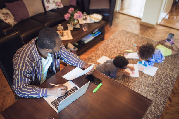 father working from home - work from home stock pictures, royalty-free photos & images