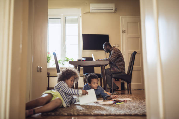 Father working from home stock photo