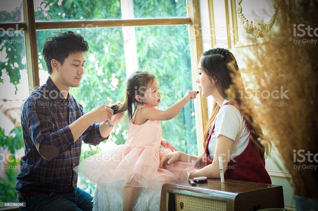 father,mother and daughter playing with makeup. royaltyfri bildbanksbilder
