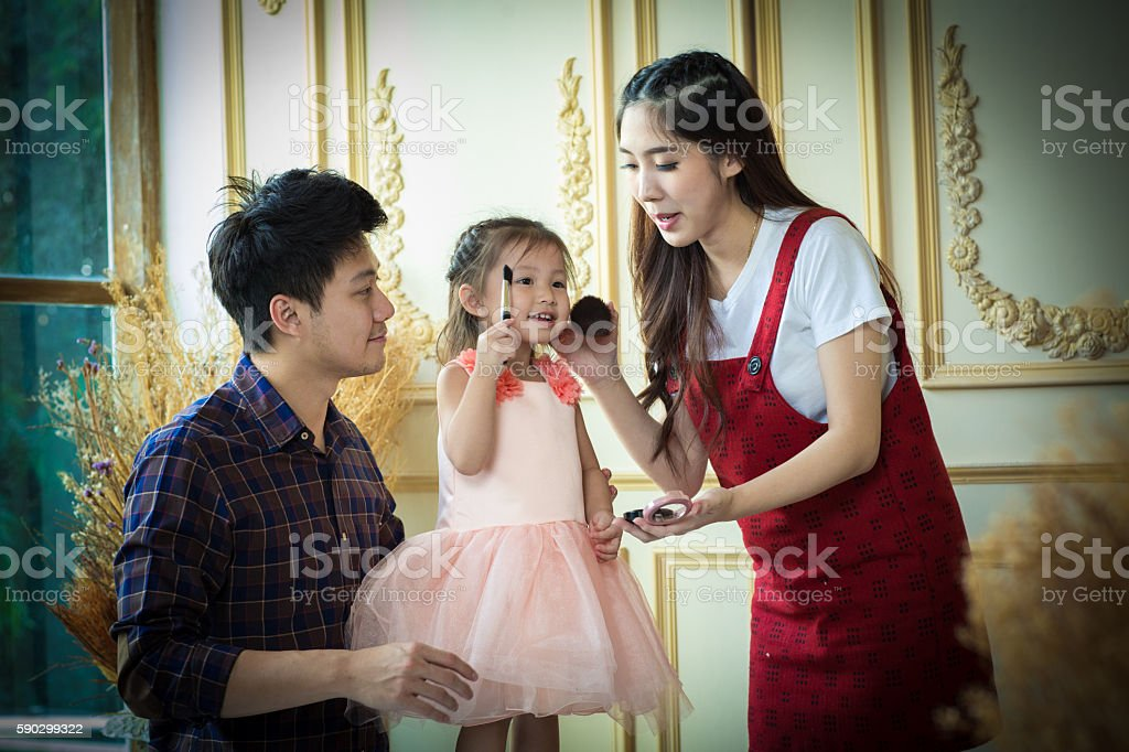 father,mother and daughter playing with makeup. royaltyfri bildbanksbilder