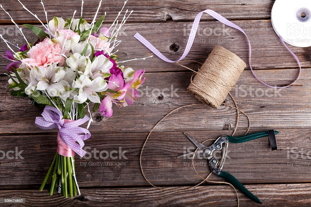 Father's Day bouquet from gillyflowers and alstroemeria on old w stock photo