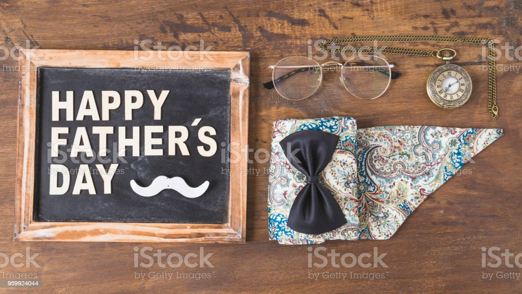 Fathers day composition with accessories and slate stock photo