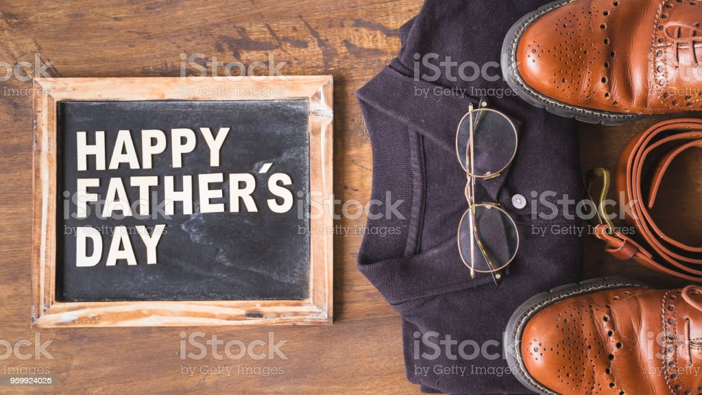 Fathers day composition with slate and clothes stock photo