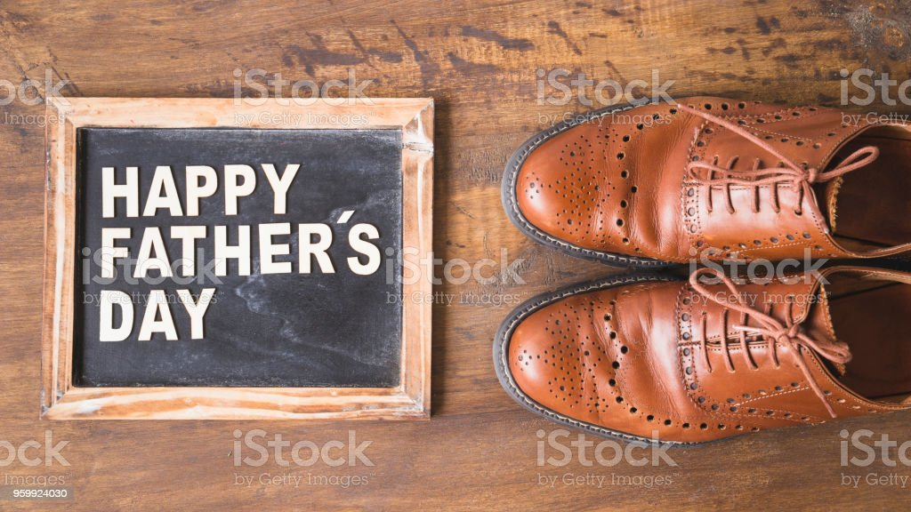 Fathers day composition with slate and shoes stock photo
