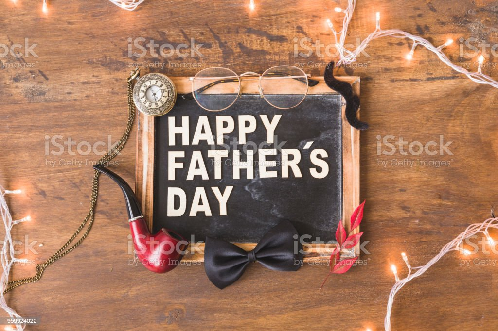 Fathers day composition with slate and string lights stock photo
