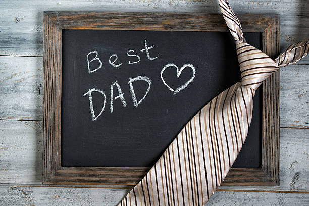 Fathers day concept, Best Dad written on chalkboard, striped tie stock photo