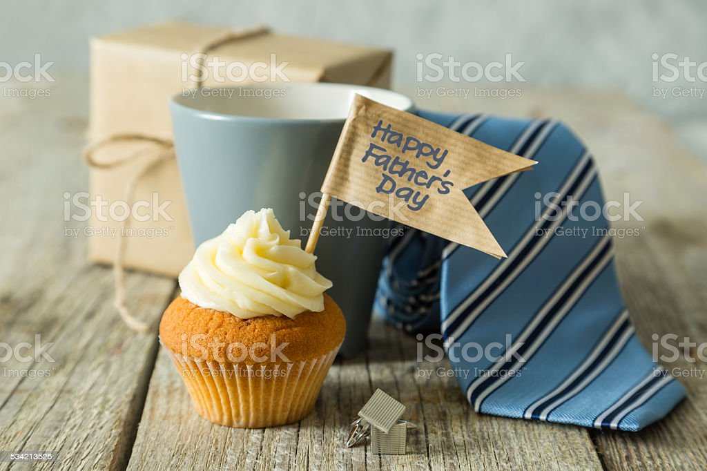 Fathers day concept - cupcake, tie, present stock photo