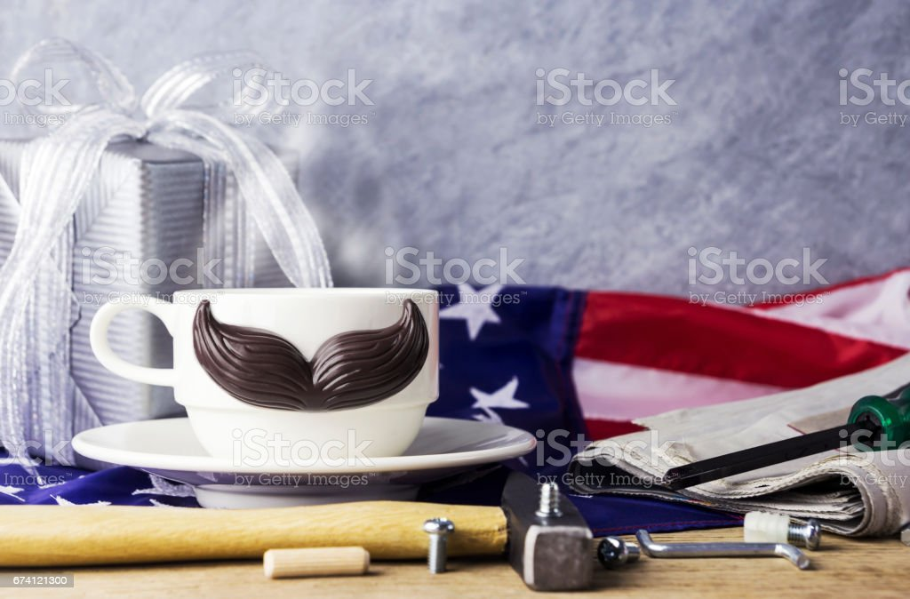 Fathers day concept of hot coffee with mustache and tool on the table and american flag 免版稅 stock photo