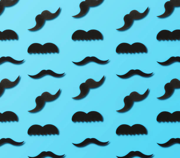 Father's Day concept. Paper mustache on blue background, top view stock photo