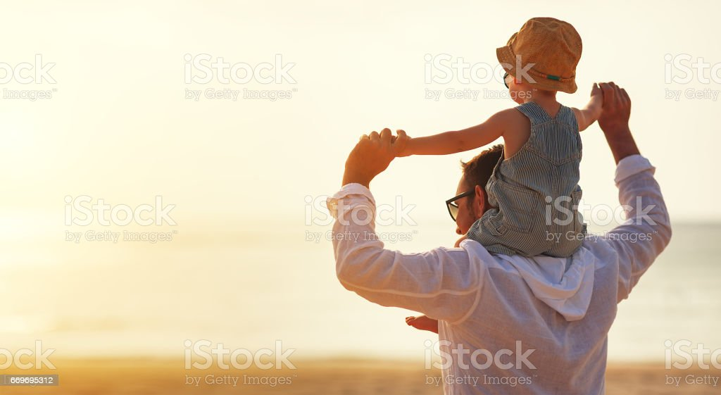 father's day. Dad and baby son playing together outdoors on a summer stock photo